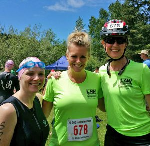 Our attorneys and paralegal supporting LAW Advocates as a team in the Lake Padden Triathlon